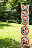 Warning sign in the garden — Stock Photo