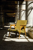 Old armchair among columns — Stock Photo