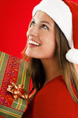 Santa Girl with present — Stock Photo