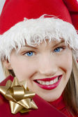 Attractive Santa girl with present — Stock Photo