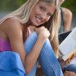 Foto Stock: Happy female student students outdoors