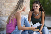 Happy female student students outdoors — Stockfoto