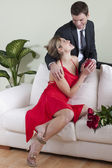 Receiving red roses and gift — Stock Photo