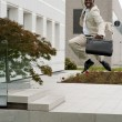 Businessman jumping of happiness - Stock fotografie