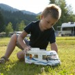 Little boy playing at camping site — Stock Photo #4125136