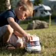 Little boy playing at camping site — Stock Photo #4125208
