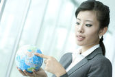 Pointing at China on Earth Globe — Stock Photo