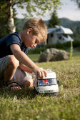 Little boy playing at camping site — Stock Photo