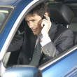Businessman on the phone inside his car — Stock Photo