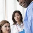 Doctors and Patient — Stock Photo #4158489