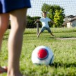 Children playing soccer — Stockfoto