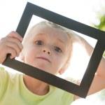 Little girl in frame — Stock Photo