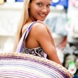 Beautiful young woman doing shopping — Stock Photo