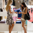 Young women buying clothes — Stock Photo