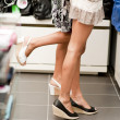 Shopping girls on tiptoe — Stock Photo