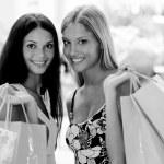Young women inside a dress shop — Stock Photo #4167865