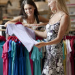 Stock Photo: Young women inside a dress shop