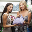 Stock Photo: Young women doing shopping