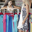 Young women inside a dress shop — Stock Photo