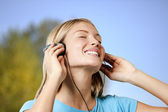 Teenage girl listening to the music — Stock Photo