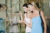 Looking through shop window — Stock Photo