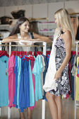 Young women inside a dress shop — Foto Stock