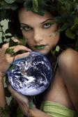 Mother nature holding something — Stock Photo