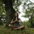 Beautiful young woman meditating in nature with hands joined. — Stock Photo
