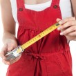 Female handworker with tape measure - Stock Photo