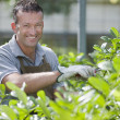 Smiling gardener - Stock Photo