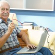 Smiling senior man at home — Stock Photo