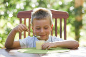 Little boy eating pudding — Stock Photo