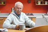 Senior man speaking through webcam — Stock Photo