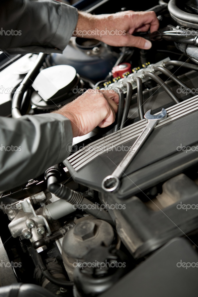 Male hand repairing car engine  Stock Photo #4210775