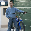 Stock Photo: Little boy with bike