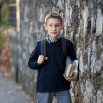 Schoolboy outdoors — Stock Photo