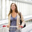 Young woman at supermarket - Stock Photo