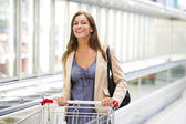 Young woman at supermarket — Stock Photo