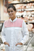 Young supermarket employee — Stock Photo