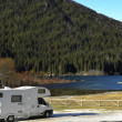 RV Parked At The Lake - Foto Stock