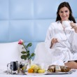 Relaxed Woman Having Breakfast in Bed — Stock Photo