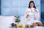 Relaxed Woman Having Breakfast in Bed — ストック写真