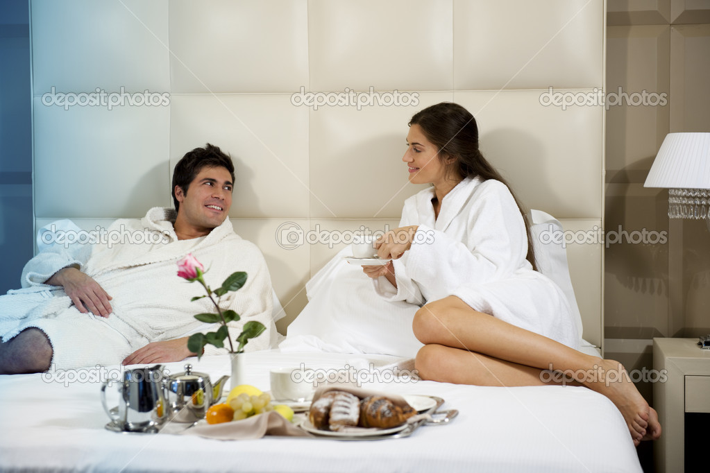 Relaxed Couple in Bed, hotel room  Stock Photo #4362291