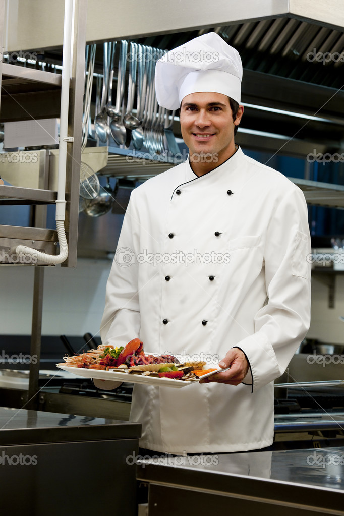 Portrait of a male chef in the restaurant  Stock Photo #4397300