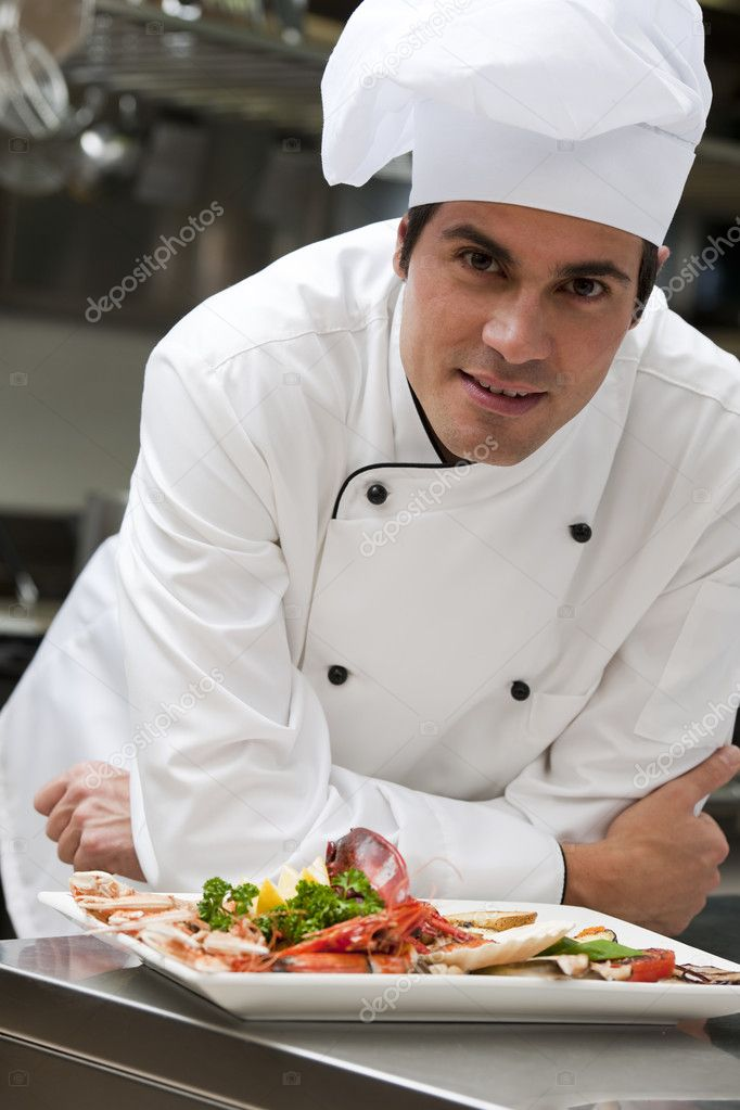 Portrait of a male chef in the restaurant — Zdjęcie stockowe #4397331