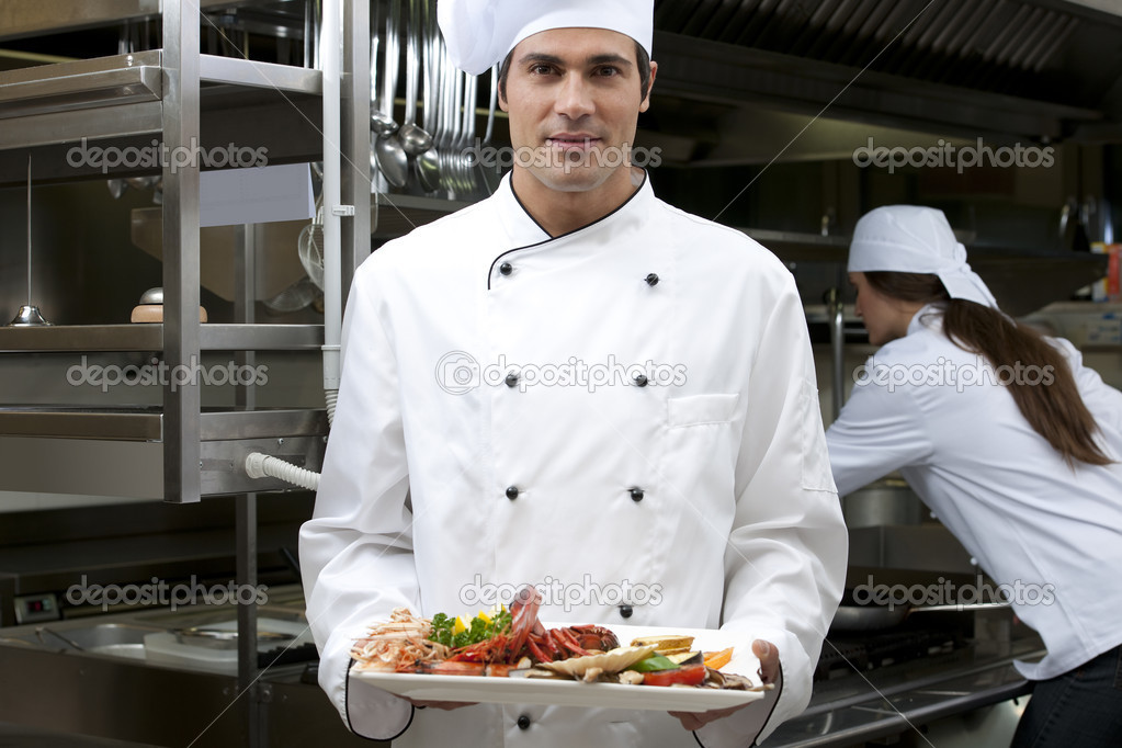 Portrait of a male chef in the restaurant — Stock Photo #4397385
