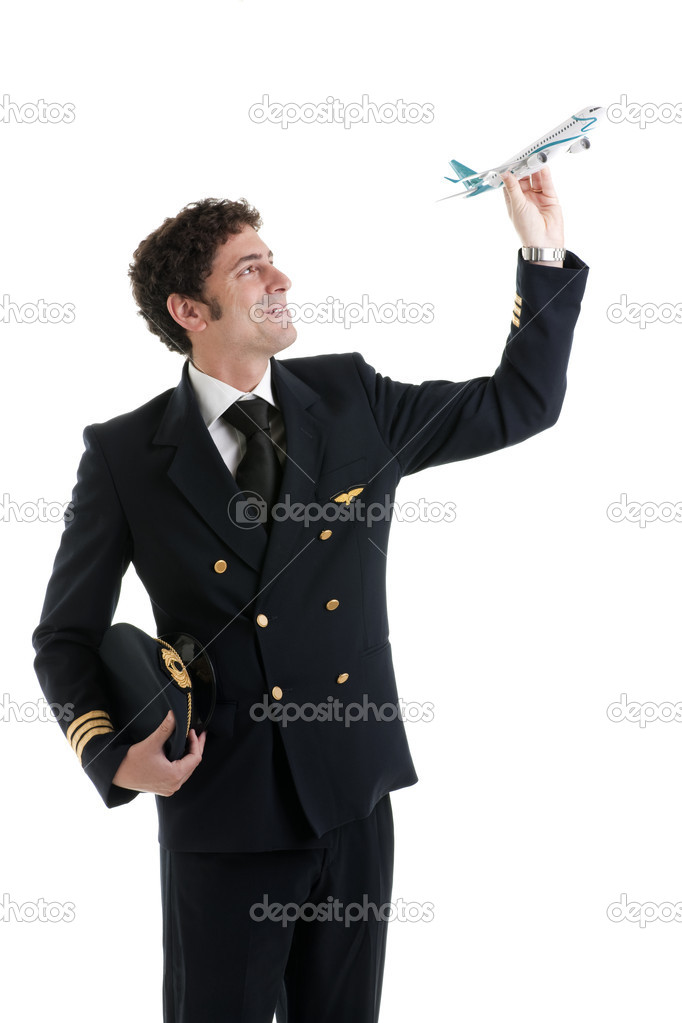 Airline Pilot/Captain with airplane model — Stock Photo #4413174