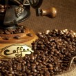 Antique coffee grinder with beans — Stock Photo #3588326