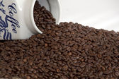 Antique coffee jar with beans — Stock Photo