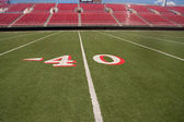 Football stadium 40 yard line — Stock Photo